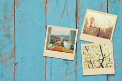 Top view of instant photos album on wooden background Stock Photo