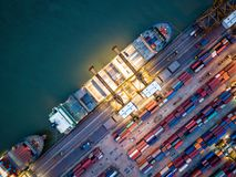 Top view of international port with Crane loading containers in. Import export business logistics at night stock photo