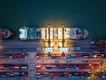 Top view of international port with Crane loading containers in. Import export business logistics at night royalty free stock photo