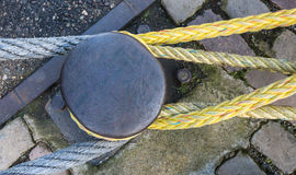 Top view of an iron bollard with ropes Stock Images