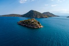 Top view of Island Koronisi near Tolo of Argolida in Peloponnese, Greece. Aerial view of Island Koronisi near Tolo of Argolida in Peloponnese, Greece. On the stock photo