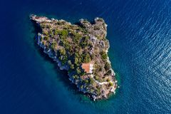 Top view of Island Koronisi near Tolo of Argolida in Peloponnese, Greece. Aerial view of Island Koronisi near Tolo of Argolida in Peloponnese, Greece. On the stock image