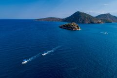 Top view of Island Koronisi near Tolo of Argolida in Peloponnese, Greece. Aerial view of Island Koronisi near Tolo of Argolida in Peloponnese, Greece. On the royalty free stock image