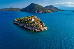 Top view of Island Koronisi near Tolo of Argolida in Peloponnese, Greece. Aerial view of Island Koronisi near Tolo of Argolida in Peloponnese, Greece. On the stock photography