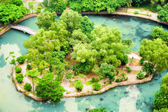 Top view of isle in middle of lake at tropical garden, Vietnam Royalty Free Stock Photo