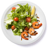 Salad with shrimp served on white plate Stock Photo