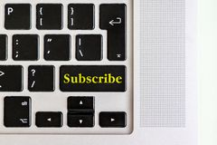 Top view isolated laptop keyboard with yellow `subscribe` text on button, concept design v stock photos