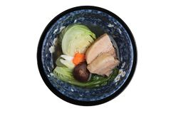 Top view of Isolated Pressure cooker pork belly Kakuni with cabbage, Japanese scallion, shiitake, carrot served in blue ceramic. Stock Photography