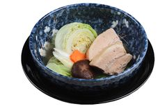 Top view of Isolated Pressure cooker pork belly Kakuni with cabbage, Japanese scallion, shiitake, carrot served in blue ceramic. Stock Image