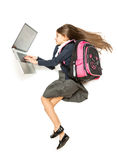 Top view isolated shot of schoolgirl with backpack using laptop Royalty Free Stock Photos