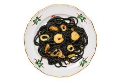 Top view of italian black pasta with seafood. Closeup of mediterranean black noodles with cuttlefish ink, mussels and shrimps stock photo