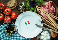 Top view italian ingredients. Top view of italian food, basil, tomatoes, olive, Mozzarella, appetizer, snack. Place for text stock images
