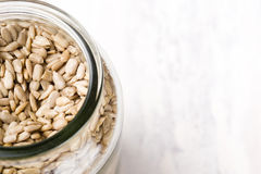 Top view of a jar filled with sunflower seeds. Royalty Free Stock Photography