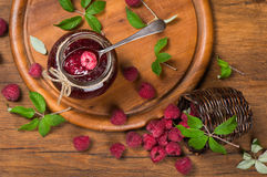 Top view of a jar of raspberry jam and  fresh berries Royalty Free Stock Image