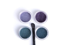 Top view of jars with eye shadows, and makeup brush Stock Photography