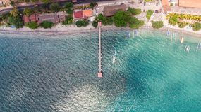 Top view jetty with janggolan boat on turquoise coastline stock photos