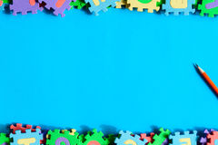 Top view jigsaw with toys and children learn Royalty Free Stock Photo