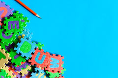 Top view jigsaw with toys and children learn Royalty Free Stock Image