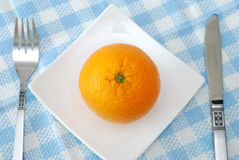 Top view of juicy orange on plate Royalty Free Stock Photos