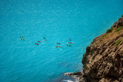 Top view of kayaking in the Adriatic sea. Kayaks aerial photo in Dubrovnik, Croatia. Rafting, extreme, team, sport fun active relaxsplashing the white water stock photo