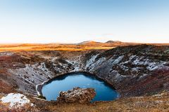 Top view of the Kerid crater with blue lake at sunrise. The Golden Circle tour. Iceland landscape. Iceland traditional and famous landscape of the Golden Circle royalty free stock image