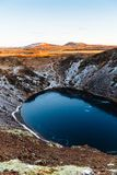 Top view of the Kerid crater with blue lake at sunrise. The Golden Circle tour. Iceland landscape. Iceland traditional and famous landscape of the Golden Circle stock photo