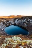 Top view of the Kerid crater with blue lake at sunrise. The Golden Circle tour. Iceland landscape. Iceland traditional and famous landscape of the Golden Circle royalty free stock photography