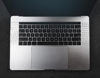 Top view of keyboard of a modern laptop with english keyboard on black stone background Stock Photos