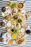 Top view on kids eating healthy dinner during birthday. Top view on kids eating healthy dinner at table during birthday party royalty free stock photos