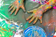 Top view of kids painted hands at table. Stock Image