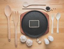 Top view kitchen mockup,Cast Iron Sizzling Steak Plate with Rural kitchen utensils on wooden table Stock Images