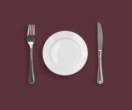 Top view of knife, plate and fork on purple Stock Photography