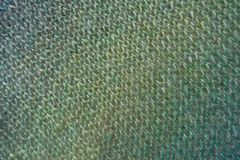 Top view of knitted fabric in shades of green. Color royalty free stock image