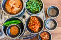 Top view of Korean side dishes filled with rich flavors vegetables. They are separated in small plates or bowled Stock Photography