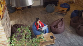 Top view lady in loft room working. stock footage