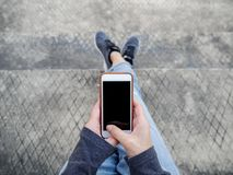Top view of a lady using smartphone for online shopping royalty free stock photography