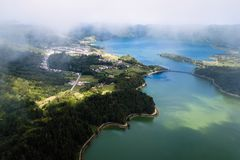 Top view of the Lagoa Verde and Lagoa Azul, lakes in Sete Cidades volcanic craters on San Miguel island. Top view of the Lagoa Verde and Lagoa Azul, lakes in royalty free stock photo