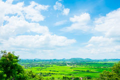 Top view Landscape of green meadow with blue sky and mountain at Stock Photography