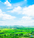Top view Landscape of green meadow with blue sky and mountain at Stock Photo