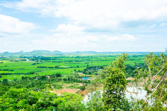 Top view Landscape of green meadow with blue sky and mountain at Royalty Free Stock Images