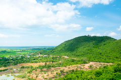 Top view Landscape of green meadow with blue sky and mountain at Royalty Free Stock Photography