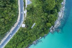 Top view landscape of tropical sea with Seafront road image by Aerial view drone shot.  royalty free stock photography