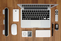 Top view of laptop computer close with smartphone, remote, mouse, speaker, portable music player, battery pack, remote. Top view flat layout of laptop computer Royalty Free Stock Images