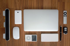 Top view of laptop computer close with smartphone, remote, mouse, speaker, portable music player, battery pack, remote Royalty Free Stock Photos