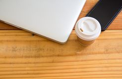 Top view of laptop computer,smartphone and cup of coffee on wood stock photos