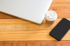 Top view of laptop computer,smartphone and cup of coffee on wood royalty free stock photos