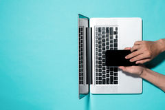 Top view with laptop and male hands using a mobile phone Stock Image