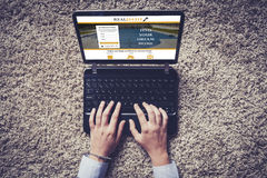 Top view of laptop with real estate website in the screen. Hands over the keyboard. Royalty Free Stock Photo