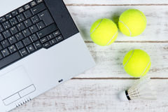 Top view of laptop, Sports Equipment, Tennis ball and Shuttlecoc Royalty Free Stock Images
