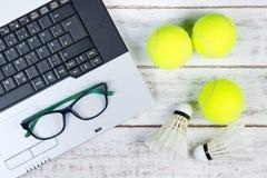 Top view of laptop, Sports Equipment, Tennis ball, Shuttlecock a Stock Photo
